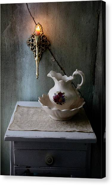 Rustic Water Closet With Brass Sconce And A Pretty Floral Patter Canvas Print