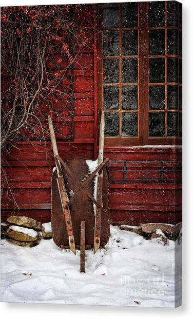 Rusty Wheelbarrow Leaning Against Barn In Winter Canvas Print
