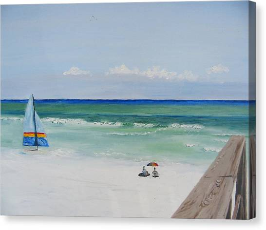 Sailboat At Blue Mountain Beach Canvas Print by John Terry