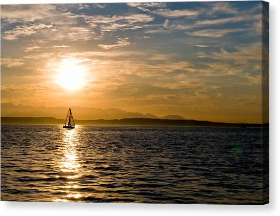 Sailing At Sunset Canvas Print by Tom Dowd