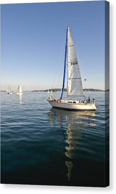 Sailing Reflection Canvas Print by Tom Dowd