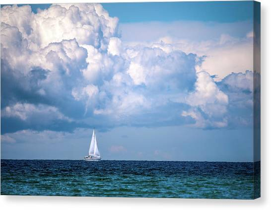 Sailing Under The Clouds Canvas Print