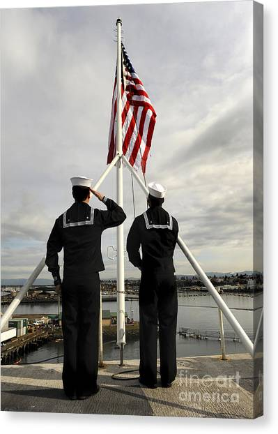 Canvas Print featuring the photograph Sailors Raise The National Ensign by Stocktrek Images