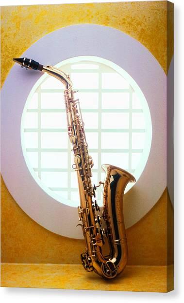 Brass Instruments Canvas Print - Saxophone In Round Window by Garry Gay