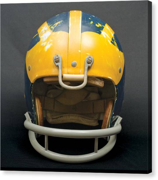 Canvas Print featuring the photograph Scarred 1970s Wolverine Helmet by Michigan Helmet