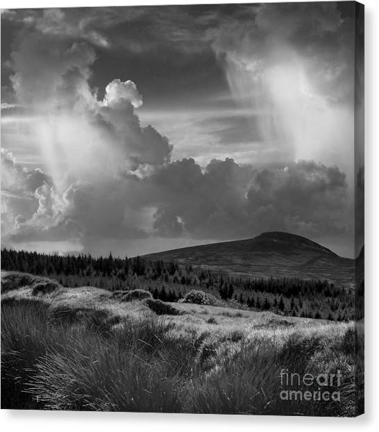 Scattering Clouds Over The Cronk Canvas Print