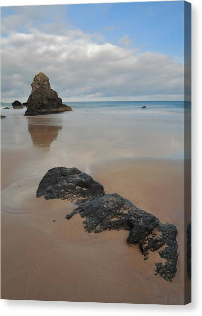 Sea Stack And Jurassic Looking Rock On Sango Bay Canvas Print by Maria Gaellman