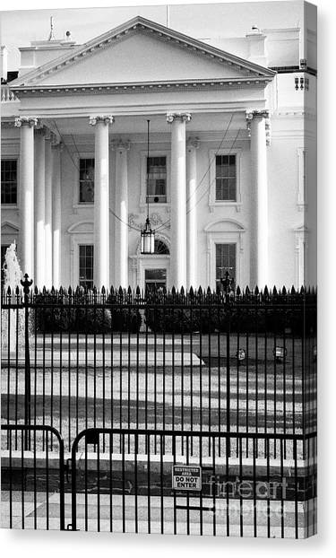 Whitehouse Canvas Print - security fencing and restricted area sign outside north facade of the White House Washington DC USA by Joe Fox