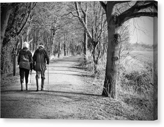 Canvas Print - Senior Couple Walking Through The Woods by Fizzy Image