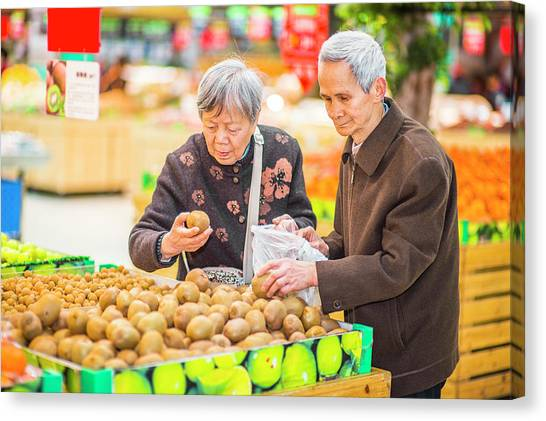 Senior Man And Woman Shopping Fruit Canvas Print