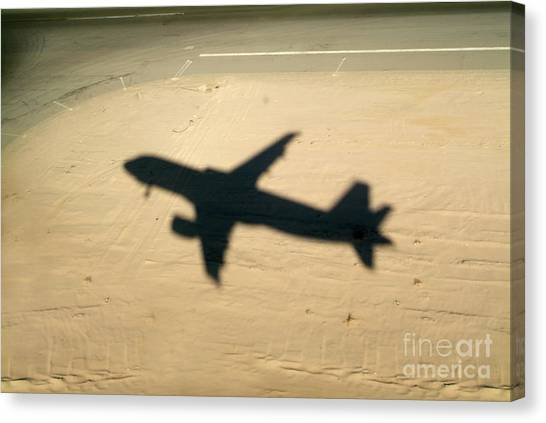Shadow Of Airplane Flying Into Land Canvas Print by Sami Sarkis