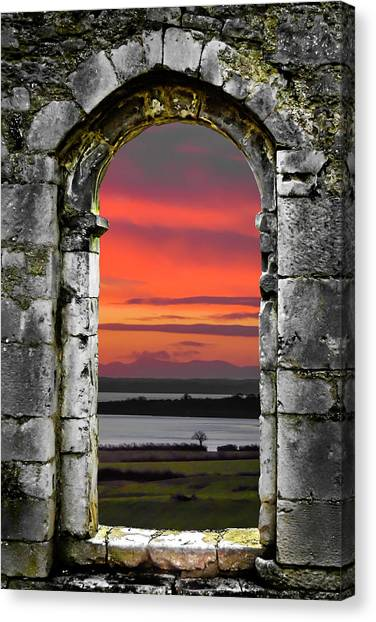 Canvas Print featuring the photograph Shannon Sunrise Through Medieval Arch by James Truett