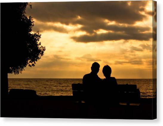 Sharing A Sunset Canvas Print by Carl Jackson