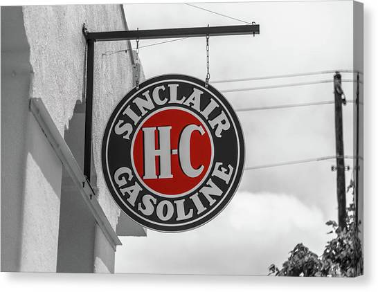 Canvas Print featuring the photograph Sinclair Gasoline Round Sign In Selective Color by Doug Camara