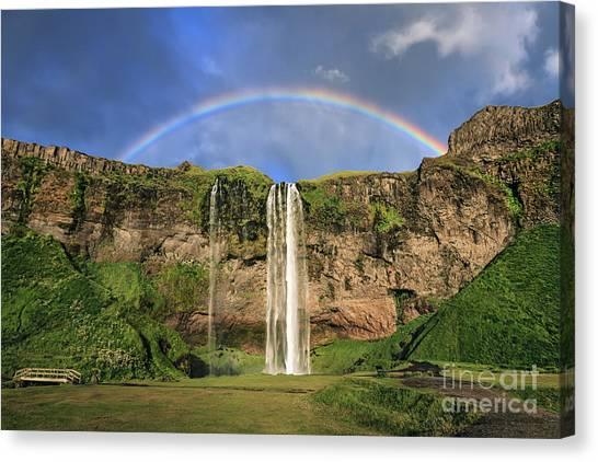Seljalandsfoss Canvas Print - Sing Me A Rainbow by Evelina Kremsdorf