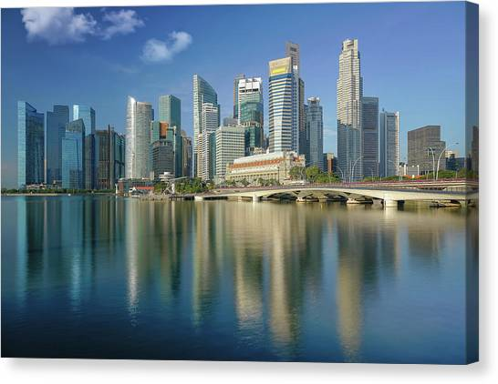 Singapore Skyline Canvas Print - Singapore City And Building In Day Time With Water Flont And Ref by Anek Suwannaphoom