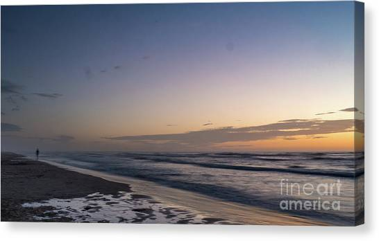 Single Man Walking On Beach With Sunset In The Background Canvas Print