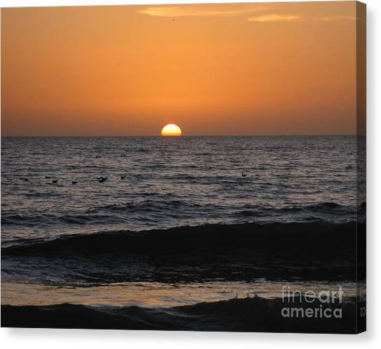 Tequila Sunrise Canvas Print - Sinking Sun - Setting Over Waves Silhouette Under Orange Sky by Sylvie Marie