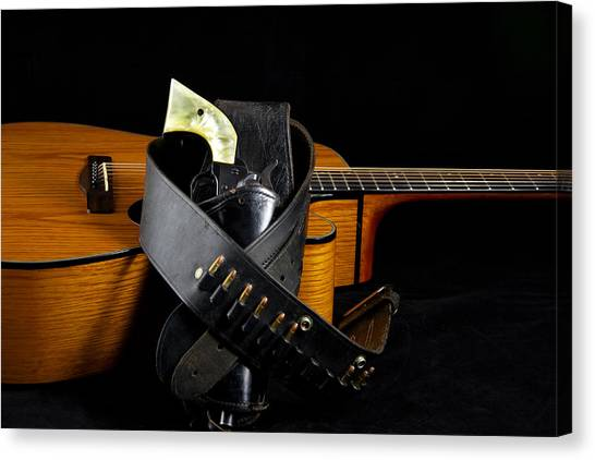 Six Gun And Guitar On Black Canvas Print