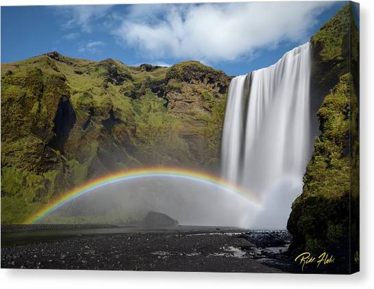 Canvas Print featuring the photograph Skogafoss And Companion Rainbow by Rikk Flohr