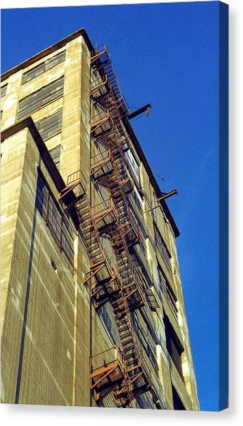 Canvas Print featuring the photograph Sky High Warehouse by T Brian Jones