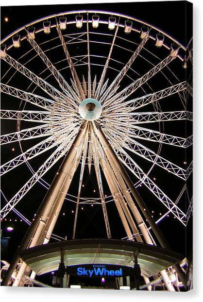 Sky Wheel Canvas Print by Heather Weikel