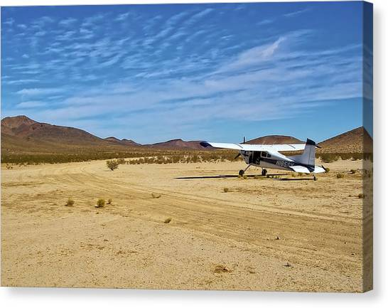 Landing strip canvas prints page 5 of 6 fine art america landing strip canvas print skywagon 185 cessna on sand landing strip by waterdancer mozeypictures Gallery