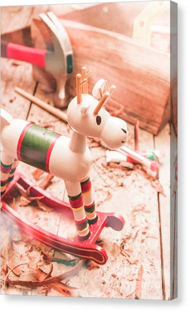 Small Mammals Canvas Print - Small Xmas Reindeer On Wood Shavings In Workshop by Jorgo Photography - Wall Art Gallery