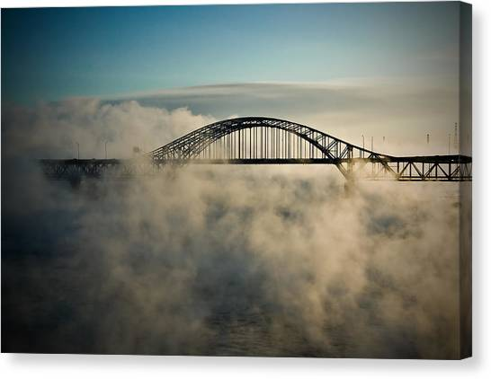 Smoke On The Water Canvas Print by Michel Filion