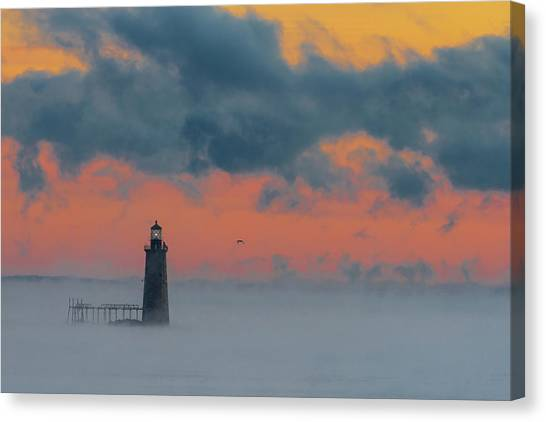 Smokey Sunrise At Ram Island Ledge Light Canvas Print