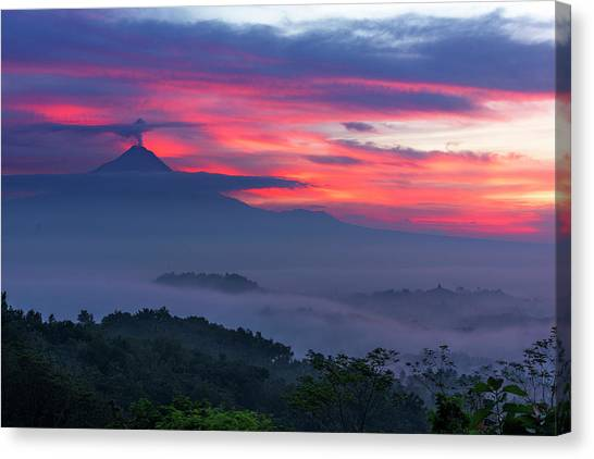 Canvas Print featuring the photograph Smoking Volcano And Borobudur Temple by Pradeep Raja Prints