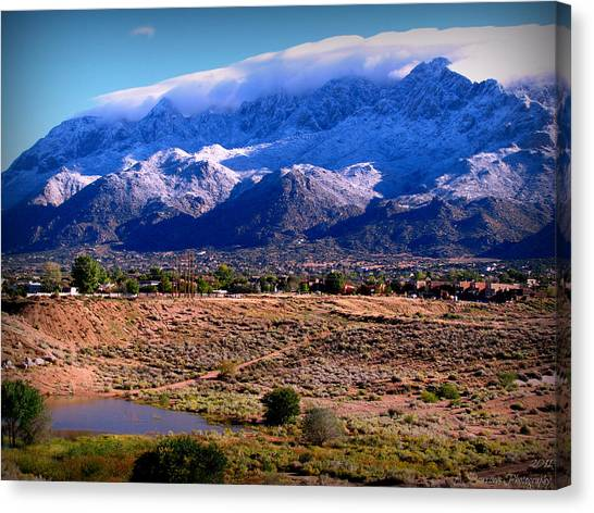 Snow Covered Mountains Above The Pond Canvas Print