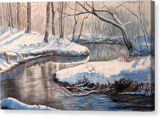 Snow On Riverbank Canvas Print by Debbie Homewood