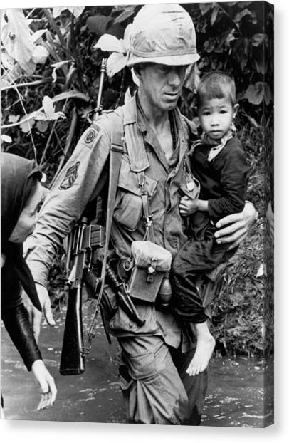 Vietnam War Canvas Print - Soldier Carrying Boy by Underwood Archives