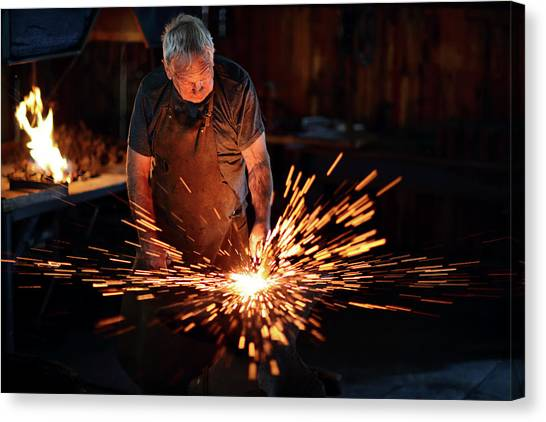 Hammers Canvas Print - Sparks When Blacksmith Hit Hot Iron by Johan Swanepoel