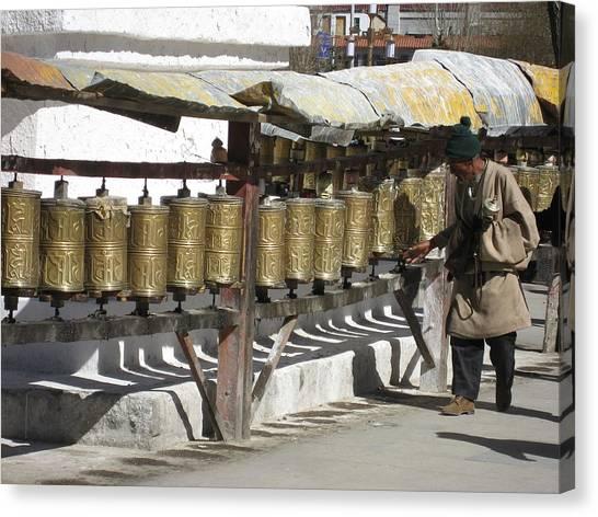 Spinning The Prayer Wheels In Lhasa  Canvas Print by James Lukashenko