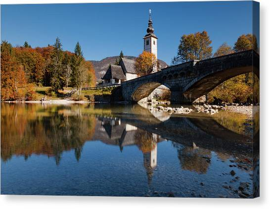 Canvas Print featuring the photograph St. John The Baptist On The Lake Bohinj by Davor Zerjav