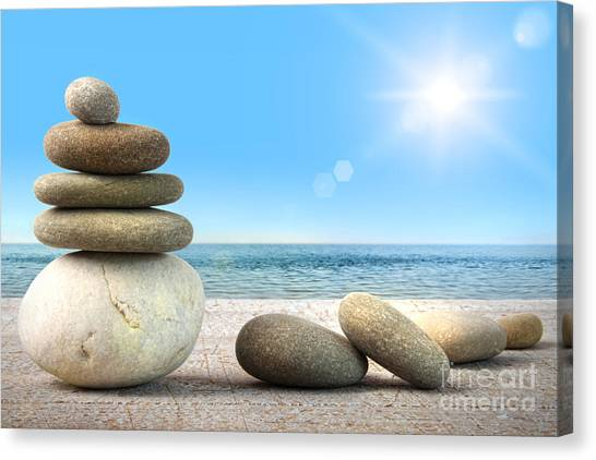 Peace Tower Canvas Print - Stack Of Spa Rocks On Wood Against Blue Sky by Sandra Cunningham