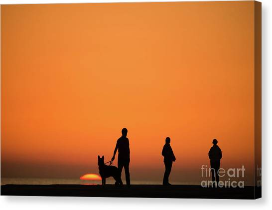 Standing At Sunset Canvas Print