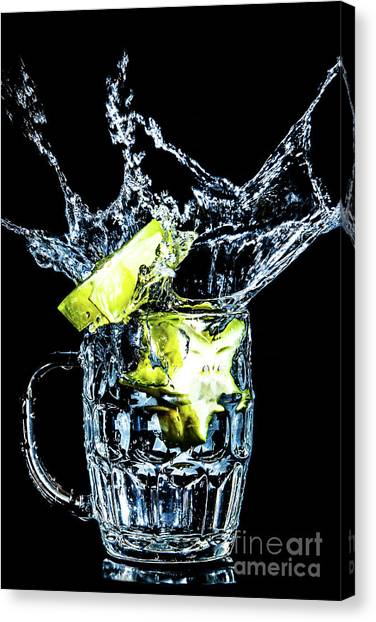 Canvas Print featuring the photograph Star Fruit Splash by Ray Shiu