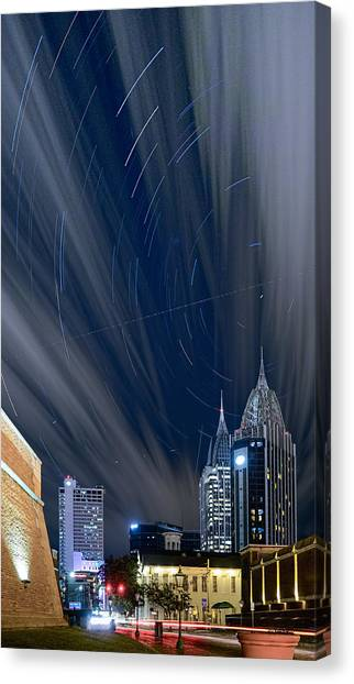 Star Trails And City Lights Canvas Print
