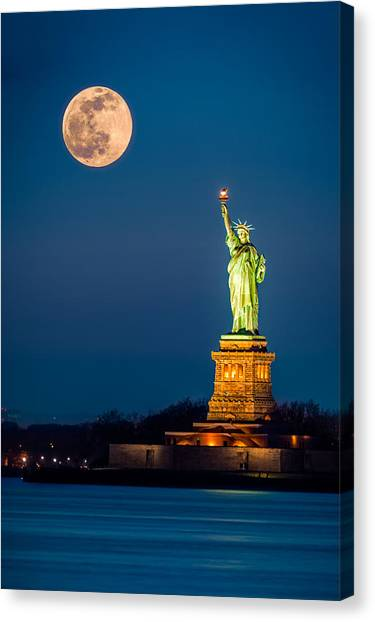 Statue Of Liberty And A Rising Supermoon In New York City Canvas Print