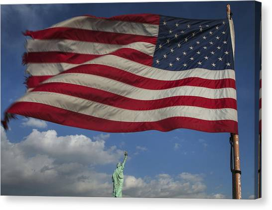 Statue Of Liberty Under The Flag Canvas Print