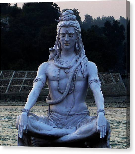 Hinduism Canvas Print - Statue Of Lord Shiva On The Banks Of Ganga At Rishikesh by Iqbal Misentropy