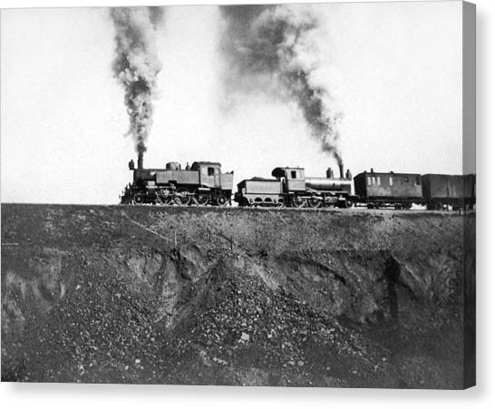 Pollution Canvas Print - Steam Engines Pulling A Train by Underwood Archives