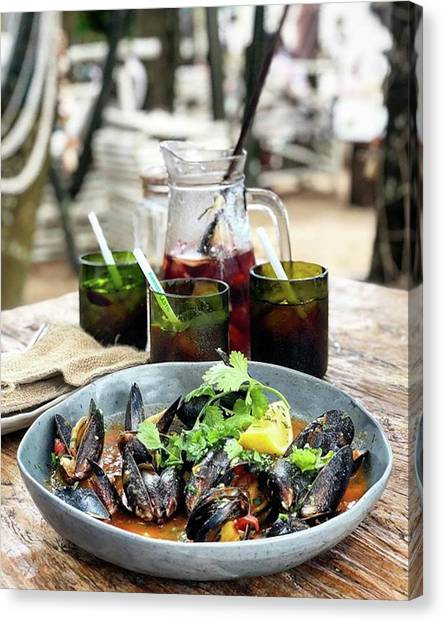Steamed Black Mussells And Paradise Canvas Print by Arya Swadharma