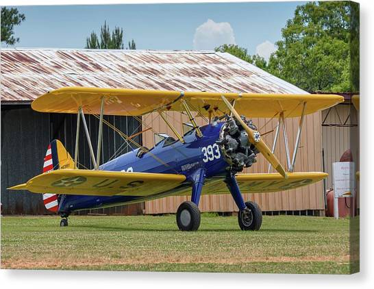 Stearman And Old Hangar Canvas Print
