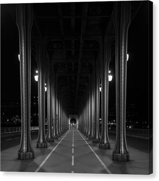 Canvas Print featuring the photograph Steel Colonnades In The Night by Denis Rouleau