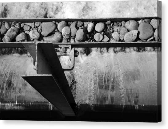 Steel Water Rocks Canvas Print by Alasdair Turner