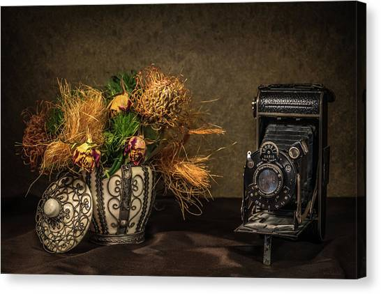 Still Life With Flowers And Camera Canvas Print